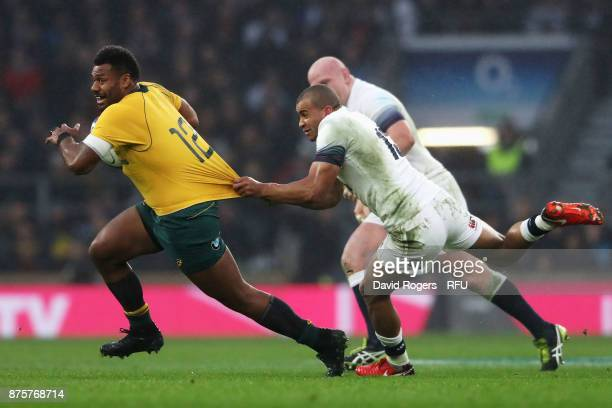 Samu Kerevi of Australia is held back by Jonathan Joseph of England during the Old Mutual Wealth Series match between England and Australia at...