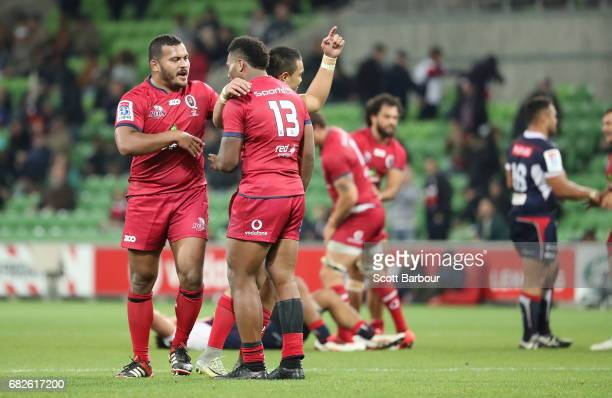 Samu Kerevi of the Reds and his teammates celebrates after dismissing rate winning the round 12 Super Rugby match between the Melbourne Rebels and...