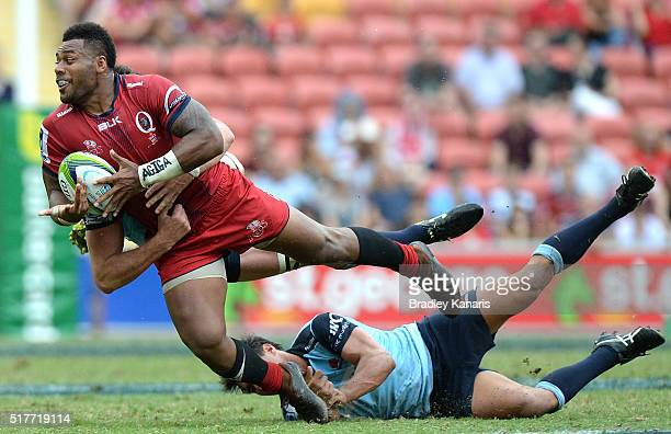 Samu Kerevi of the Reds attempts to get a pass away during the round five Super Rugby match between the Reds and the Waratahs at Suncorp Stadium on...