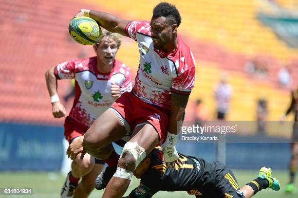 Samu Kerevi of the Reds breaks away from the defence during the Rugby Global Tens match between the Queensland Reds and Chiefs at Suncorp Stadium on...