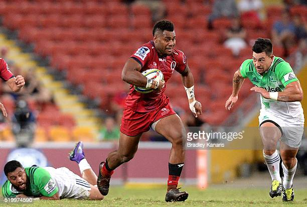 Samu Kerevi of the Reds breaks through the defence during the round seven Super Rugby match between the Reds and the Highlanders at Suncorp Stadium...