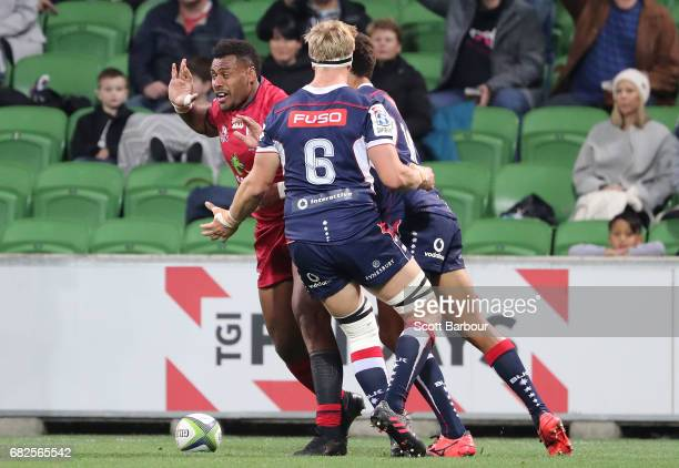Samu Kerevi of the Reds celebrates after scoring the first try of the match during the round 12 Super Rugby match between the Melbourne Rebels and...