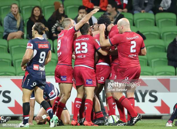 Samu Kerevi of the Reds is congratulated by his teammates after scoring the matchwinning try during the round 12 Super Rugby match between the...
