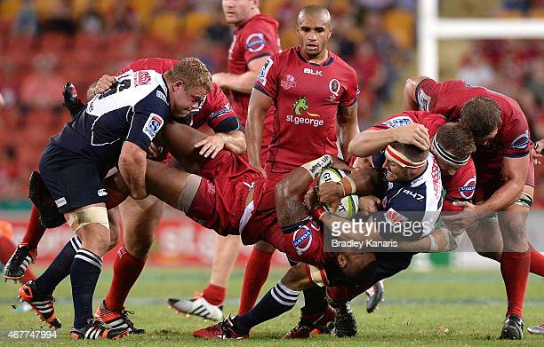 Samu Kerevi of the Reds is picked up in the tackle during the round seven Super Rugby match between the Reds and the Lions at Suncorp Stadium on...