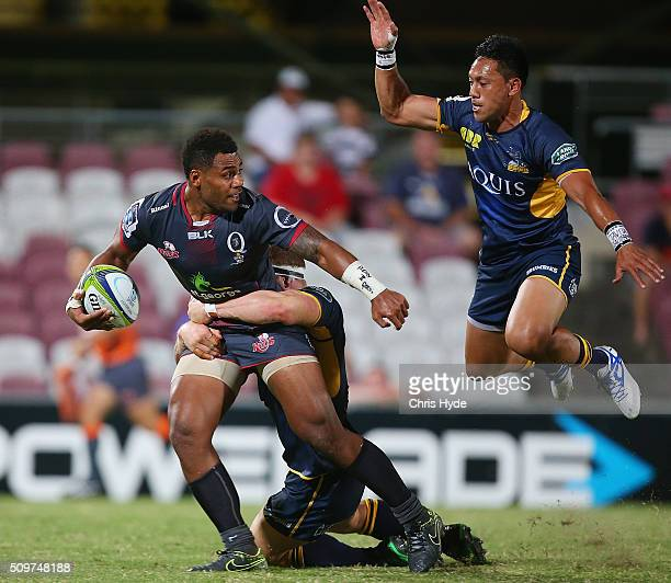 Samu Kerevi of the Reds is tackled by David Pocock of the Brumbies during the Super Rugby PreSeason match between the Reds and the Brumbies at...