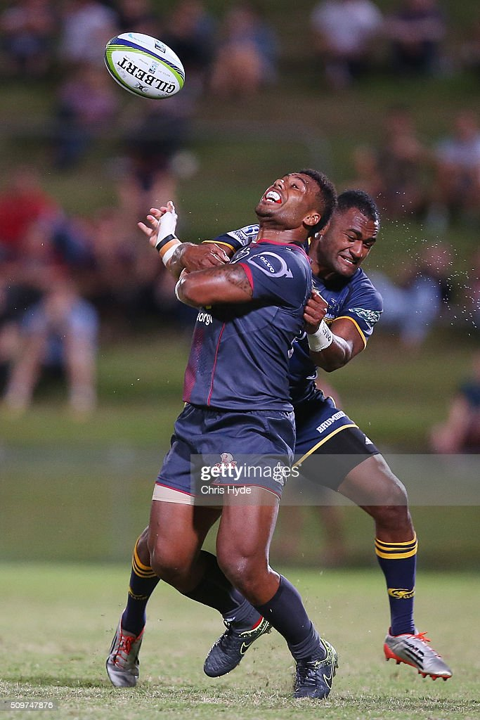 Samu Kerevi of the Reds is tackled by Tevita Kuridrani of the Brumbies during the Super Rugby Pre-Season match between the Reds and the Brumbies at Ballymore Stadium on February 12, 2016 in Brisbane, Australia.