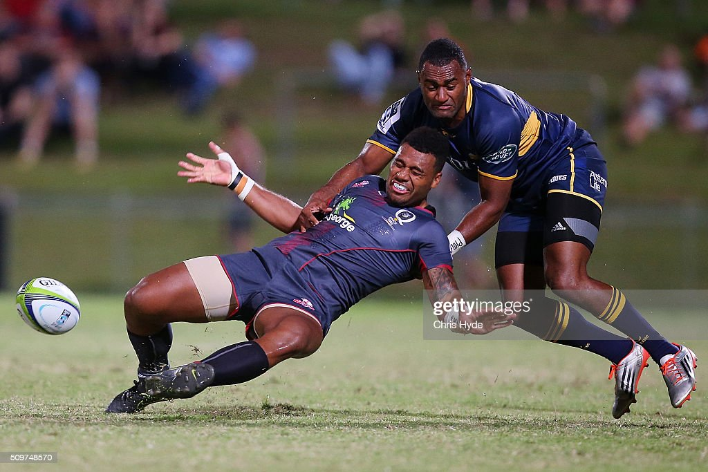 Samu Kerevi of the Reds is tackled by <a gi-track='captionPersonalityLinkClicked' href=/galleries/search?phrase=Tevita+Kuridrani&family=editorial&specificpeople=7612194 ng-click='$event.stopPropagation()'>Tevita Kuridrani</a> of the Brumbies during the Super Rugby Pre-Season match between the Reds and the Brumbies at Ballymore Stadium on February 12, 2016 in Brisbane, Australia.