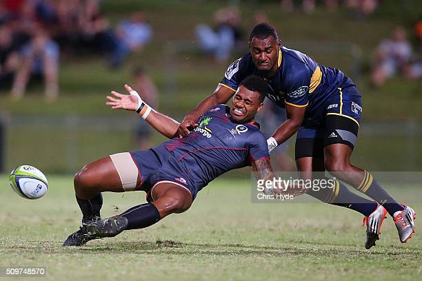 Samu Kerevi of the Reds is tackled by Tevita Kuridrani of the Brumbies during the Super Rugby PreSeason match between the Reds and the Brumbies at...