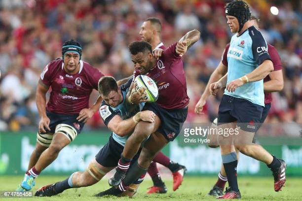 Samu Kerevi of the Reds is tackled during the round 10 Super Rugby match between the Reds and the Waratahs at Suncorp Stadium on April 29 2017 in...
