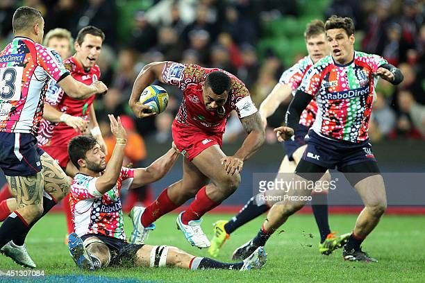 Samu Kerevi of the Reds is tackled during the round 17 Super Rugby match between the Rebels and the Reds at AAMI Park on June 27 2014 in Melbourne...