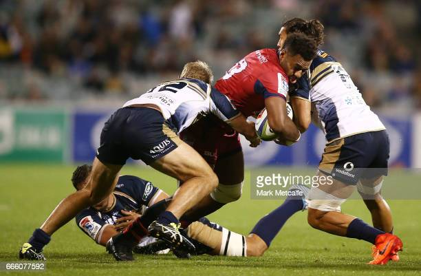 Samu Kerevi of the Reds is tackled during the round seven Super Rugby match between the Brumbies and the Reds at GIO Stadium on April 8 2017 in...