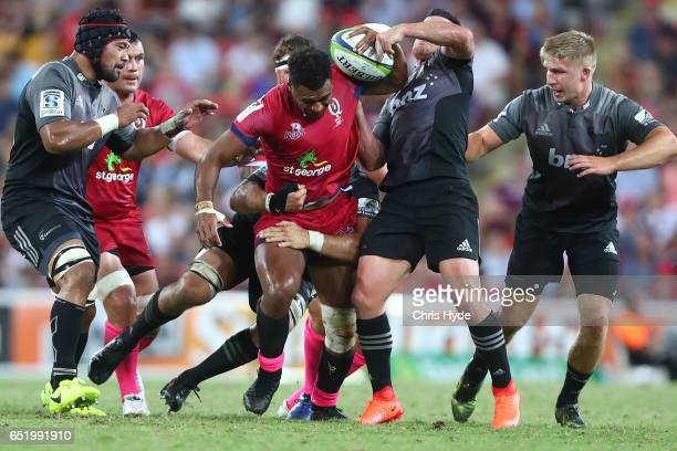 Samu Kerevi of the Reds is tackled during the round three Super Rugby match between the Reds and the Crusaders at Suncorp Stadium on March 11 2017 in...