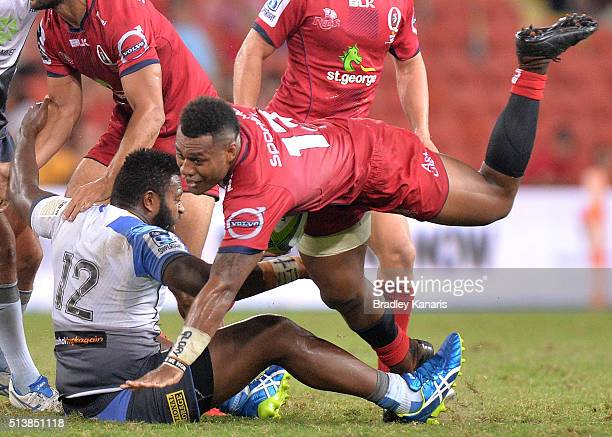 Samu Kerevi of the Reds is tackled during the round two Super Rugby match between the Reds and the Force at Suncorp Stadium on March 5 2016 in...