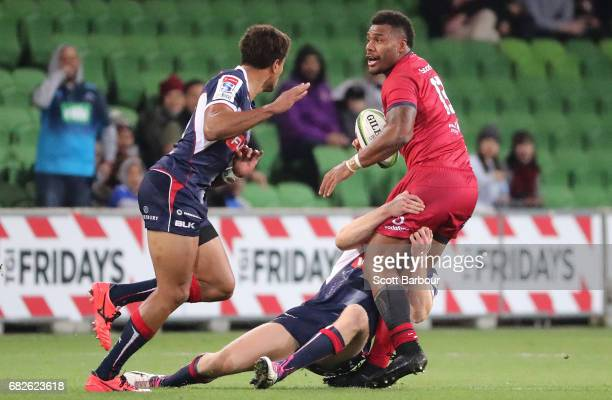 Samu Kerevi of the Reds runs with the ball during the round 12 Super Rugby match between the Melbourne Rebels and the Queensland Reds at AAMI Park on...