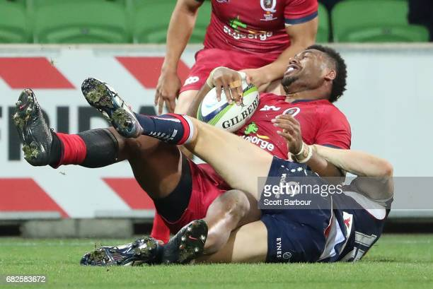 Samu Kerevi of the Reds scores the matchwinning try during the round 12 Super Rugby match between the Melbourne Rebels and the Queensland Reds at...