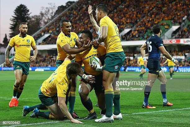 Samu Kerevi of the Wallabies is congratulated by team mates after scoring a try during the Rugby Championship match between the Australian Wallabies...