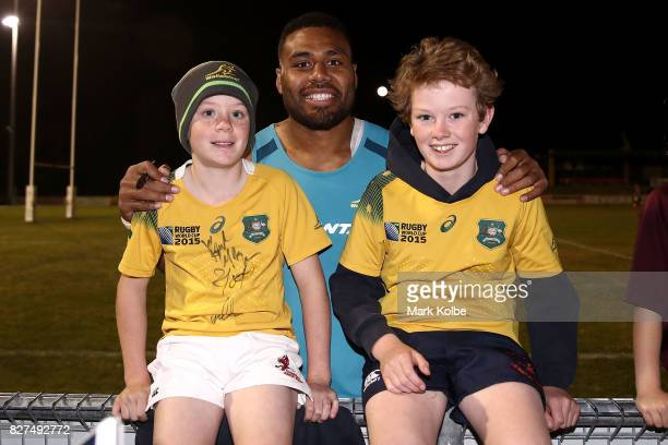 Samu Kerevi poses with supporters after an Australian Wallabies training session at Cessnock Sportsground on August 8 2017 in Newcastle Australia