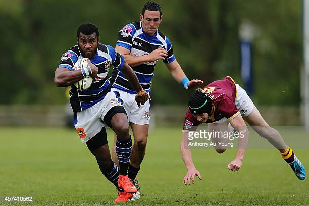 Samu Kubunavanua of Wanganui beats the tackle from Zayn Tipping of King Country during the Lochore Cup Semi Final match between King Country and...