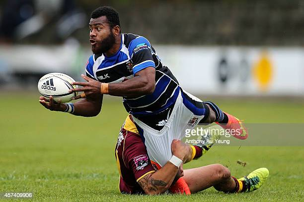 Samu Kubunavanua of Wanganui offloads in tackle from Dean Church of King Country during the Lochore Cup Semi Final match between King Country and...