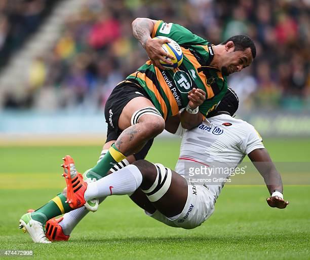 Samu Manoa of Northampton Saints is tackled by Maro Itoje of Saracens during the Aviva Premiership Play Off Semi Final between Northampton Saints and...