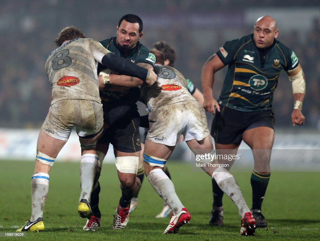 Samu Manoa of Northampton Saints tangles with Jannie Bornman and Anton Antonie Claasseni of Castres Olympique during the Heineken Cup match between Northampton Saints and Castres Olympique at Franklin's Gardens on January 11, 2013 in Northampton, England.