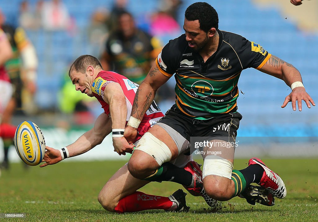 Samu Manoa of Northampton tackles Gordon Ross of London Welsh during the Aviva Premiership match between London Welsh and Northampton Saints at Kassam Stadium on April 14, 2013 in Oxford, England.