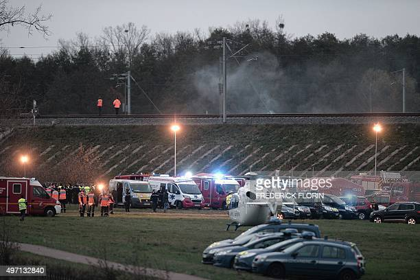 A Samu rescue helicopter and ambulances stands by at the scene where a highspeed TGV train coach and engine carriage derailed into a canal in...