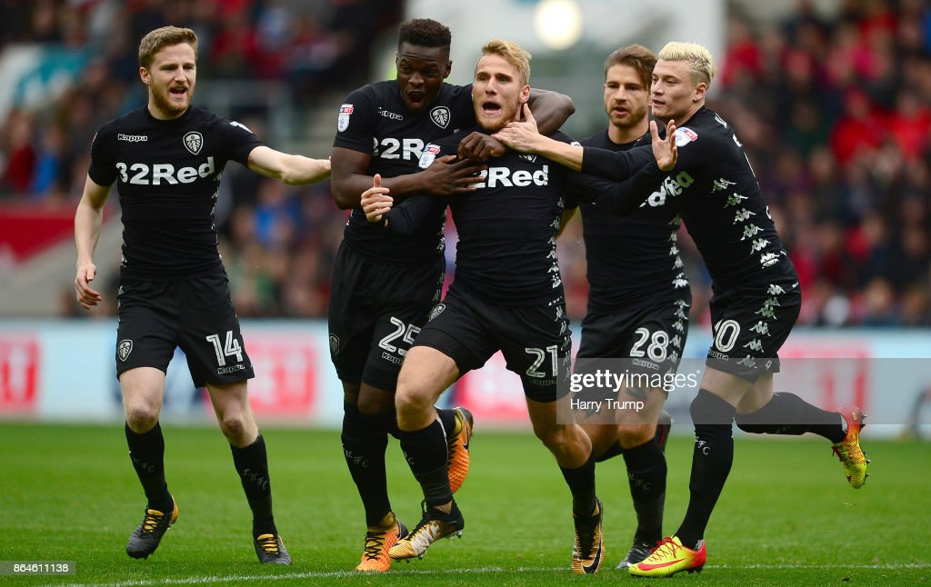 Samu Saiz of Leeds United (C) celebrates his sides first goal with team mates during the Sky Bet Championship match between Bristol City and Leeds United at Ashton Gate on October 21, 2017 in Bristol, England.