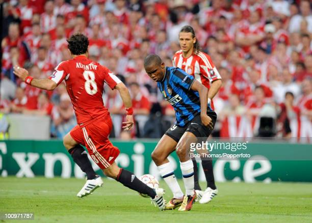 Samual Eto'o of Inter Milan is watched by Hamit Altintop of Bayern Munich during the UEFA Champions League Final match between Bayern Munich and...