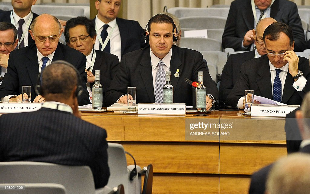 Samuel Armando Reyes Rendon Vice President of the Republic of Honduras (C), looks on nexT to Italian Minister of Foreign Affairs Franco Frattini (R) and Argentine Minister of Foreign Affairs Hector Timerman during the '5th Italy-Latin America and Caribbean Conference', on October 5, 2011 at the Foreign Ministry in Rome.