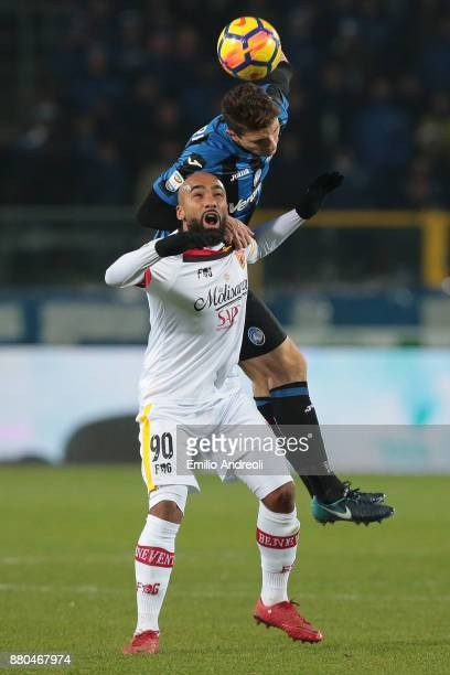 Samuel Armenteros of Benevento Calcio jumps for the ball with Mattia Caldara of Atalanta BC during the Serie A match between Atalanta BC and...