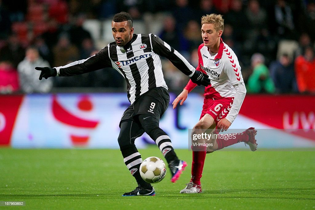 Samuel Armenteros of Heracles Almelo, Johan Martensson of FC Utrecht during the Dutch Eredivisie match between Heracles Almelo and FC Utrecht at the Polman Stadium on December 7, 2012 in Almelo, The Netherlands.