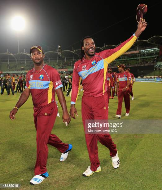 Samuel Badree and Chris Gayle of the West Indies celebrate their teams win over Pakistan after the ICC World Twenty20 Bangladesh 2014 match between...
