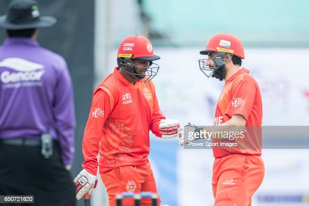 Samuel Badree of HKI United celebrates with his teammate Misbah UlHaq during the Hong Kong T20 Blitz match between Hung Hom JD Jaguars and HKI United...