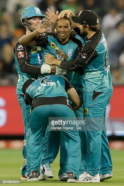 Samuel Badree of the Brisbane Heat is congratulated by team mates after taking the wicket oh Luke Wright of the Melbourne Stars during the Big Bash...