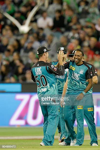 Samuel Badree of the Brisbane Heat is congratulated by team mates after the wicket of Rob Quiney of the Melbourne Stars during the Big Bash League...