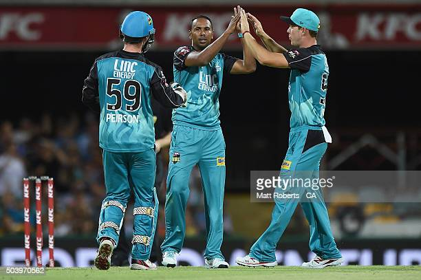 Samuel Badree of the Heat celebrates a wicket with team mates during the Big Bash League match between the Brisbane Heat and the Adelaide Strikers at...