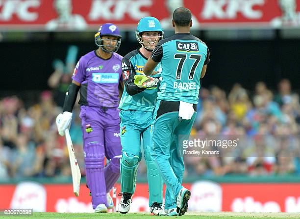 Samuel Badree of the Heat celebrates taking the wicket of Kumar Sangakkara of the Hurricanes during the Big Bash League between the Brisbane Heat and...