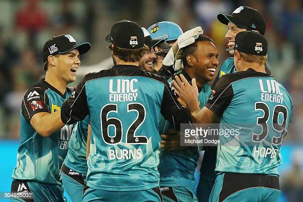 Samuel Badree of the Heat celebrates the wicket of Rob Quiney of the Stars during the Big Bash League match between the Melbourne Stars and the...