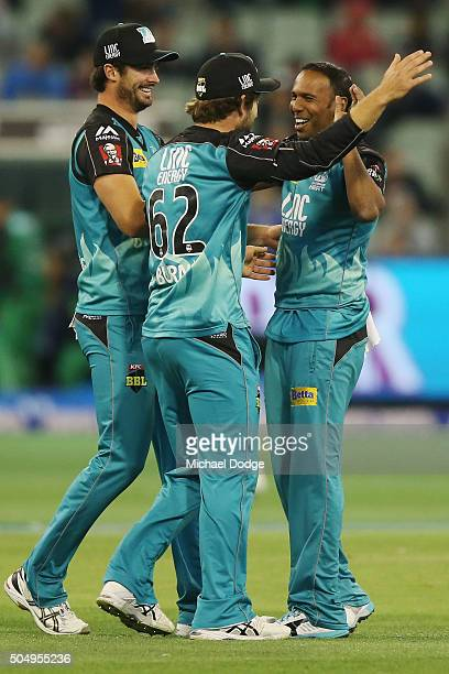 Samuel Badree of the Heat celebrates the wicket of Rob Quiney of the Stars with Ben Cutting and Joe Burns during the Big Bash League match between...