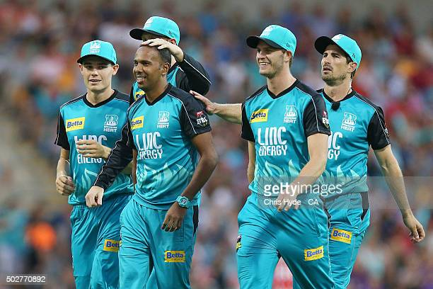 Samuel Badree of the Heat celebrates with team mates after dismissing Ben Dunk of the Hurricanes during the Big Bash League match between the...