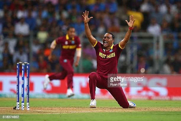 Samuel Badree of the West Indies appeals for the wicket of Rohit Sharma of India during the ICC World Twenty20 India 2016 Semi Final match between...