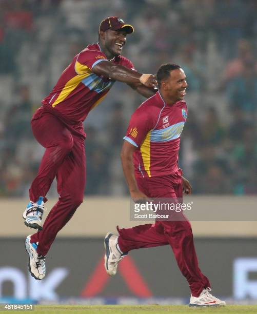 Samuel Badree of the West Indies is congratulated by Darren Sammy after dismissing Shoaib Malik of Pakistan during the ICC World Twenty20 Bangladesh...