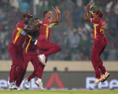 Samuel Badree of the West Indies is congratulated by his teammates after dismissing Shoaib Malik of Pakistan during the ICC World Twenty20 Bangladesh...
