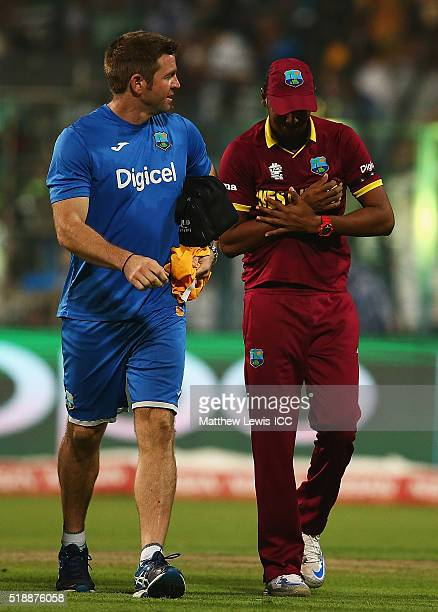 Samuel Badree of the West Indies receives treatment after catching Liam Plunkett of England during the ICC World Twenty20 India 2016 Final between...