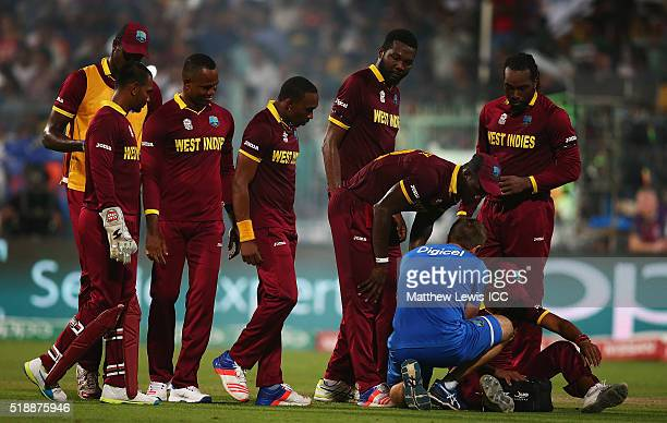 Samuel Badree of the West Indiesreceives treatment after catching Liam Plunkett of England during the ICC World Twenty20 India 2016 Final between...