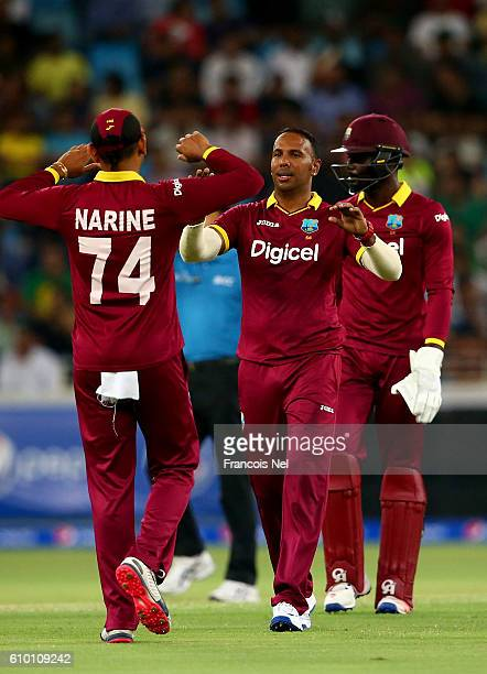 Samuel Badree of West Indies celebrates with teammates after dismissing Sharjeel Khan of Pakistan during the second T20 International match between...