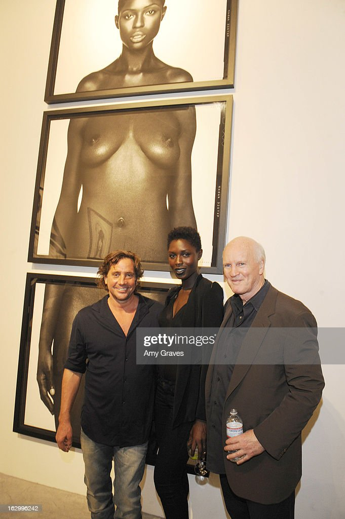Samuel Bayer, Jodie Smith and Douglas Christmas attend the Samuel Bayer Ace Gallery Exhibit Opening, presented by Panavision at Ace Gallery on March 2, 2013 in Beverly Hills, California.