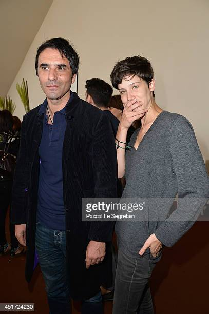Samuel Benchetrit and a guest attend the Paris Eiffel Jumping presented by Gucci at ChampdeMars on July 5 2014 in Paris France
