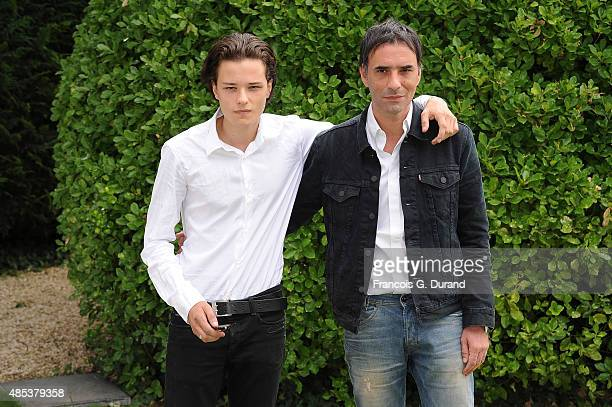 Samuel Benchetrit poses with his son Jules at a photocall for the film 'Asphalte' during the 8th Angouleme FrenchSpeaking Film Festival on August 27...